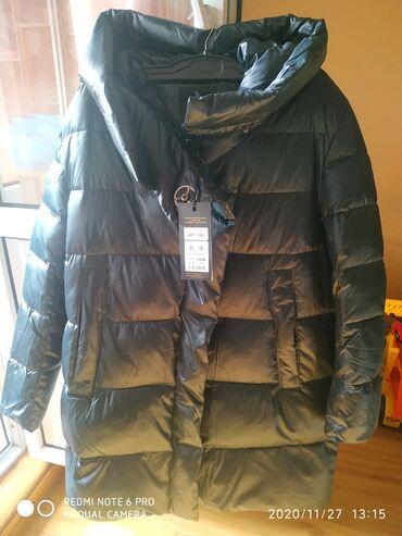 Продаю зимнию новую куртку куплена была в России размер 56 58 купили