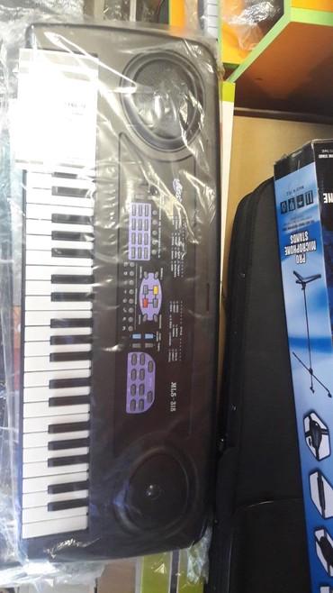 Sintizator 4 oktava yarim mikrafonlu kicik olculu temiz piano sesli