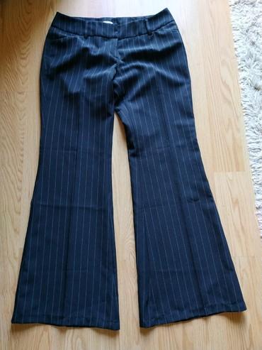 Crne-pantalone-sa-dzepovima - Srbija: Crne pantalone sa širokim nogavicama. Broj 38, sa štrafticama. Nove
