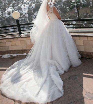 Срочно продается шикарное свадебное платье-трансформер. сшито на