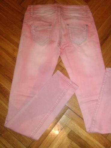 Ženska odeća | Kovin: Roze teksas farmerice skroz uske, vel 27