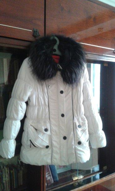 продаю зимнею куртку,в хорошем состоянии,вортник натуральный,покупали  в Токмак
