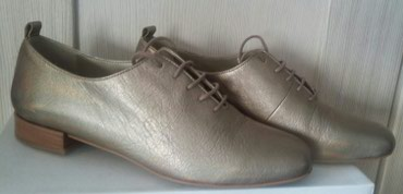 Fly sl400m - Beograd: SNIŽENO! Zlatne cipele Fly London,kožne,noveBr.39