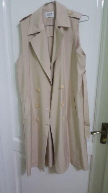 Жилетка, очень классная. можно и платье одеть. новая. брала за 4000 в Бишкек