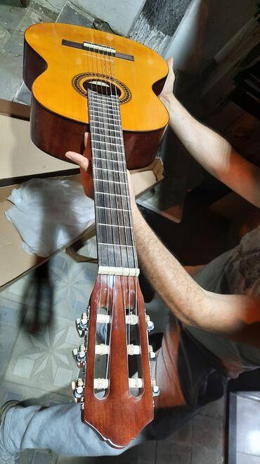 Gitara klassik yamaha c70 üzərində hazirlanib keyfiyyətli ağacdan təz