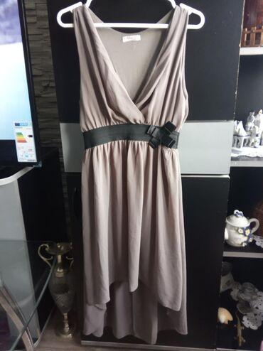 Haljine | Novi Banovci: Letnja haljina, sa postavom. Napred je kraca nazad je duza. Kao nova