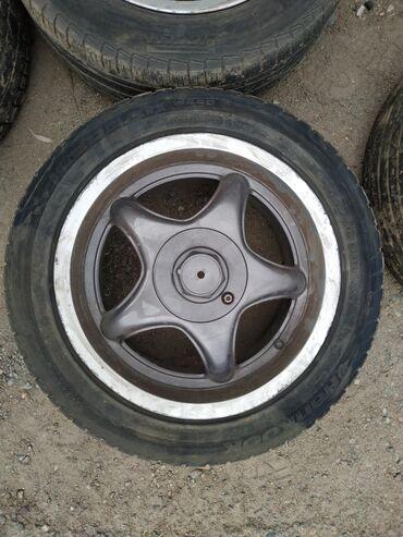 шины 205 55 r16 в Кыргызстан: Продам диски вместе с шинами. Размеры 205/55 R16. Сверловка 4×100
