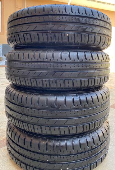 куплю диски на 14 в Кыргызстан: Продаю комплект шины и диски от Honda Jazz Fit Civic 175/65/14
