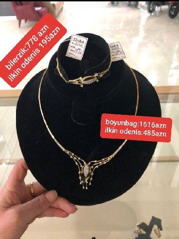 - Azərbaycan: 585 eyar, 31.93 qr,qizil zinet esyalari tek sexsiyyet vesiqesi ile