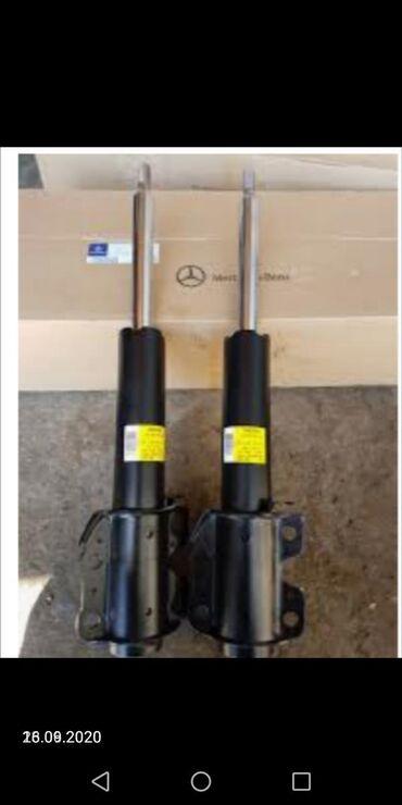 Амортизатор на мерседес 124 передний и задний