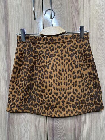 Мини-юбка в леопардовом принте. Снизу есть подклад-шорты (юбка не зади