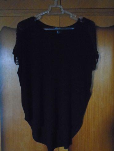 Ika-bluza-jaknica-italijanskog-brenda-biaggini - Srbija: Crna bluza sa resicama na ramenima, brenda Mango. Materijal je nežan