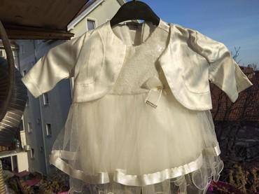 Snezno bela - Srbija: Svečana haljinica sa bolerom, obučena na sat vremena tokom samog čina