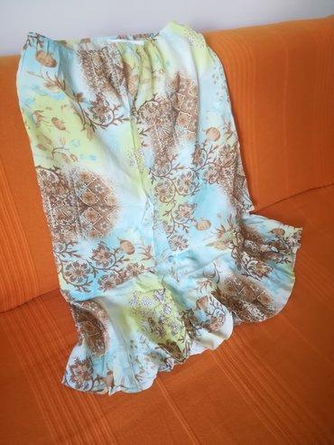 Kvalitetna suknja za tople dane sa karnerima vel 44, ima lastrež, obim