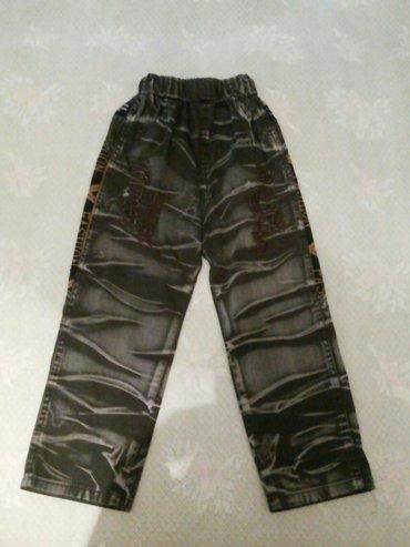 Новые джинсы на мальчика 4/5л. длина от паха 45см. в Бишкек