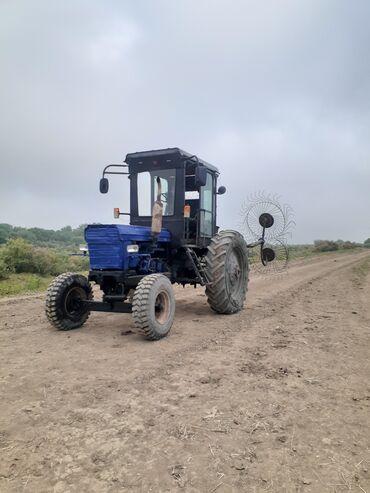 33 elan   NƏQLIYYAT: Traktor normal vəziyətdədir arxasinda dirmiğda verilir fikiri ciddi