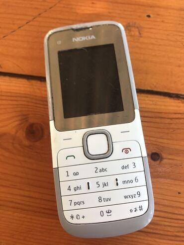 Nokia C2-00 satilir orjinaldi, usdunde adaptir verilir