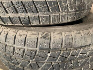 шины r18 в Кыргызстан: Продаю шины зимние. Размер 235/60/R18 2 сезона проездили, хранился в