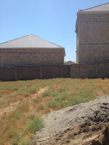 Bakı şəhərində Tecili Masazirda girise yaxin erazide dayanacaqa 200 metr arali  2 sot