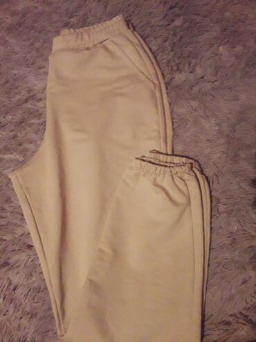 Новые бежевые брюки спортивные брюки размер стандарт на резинке