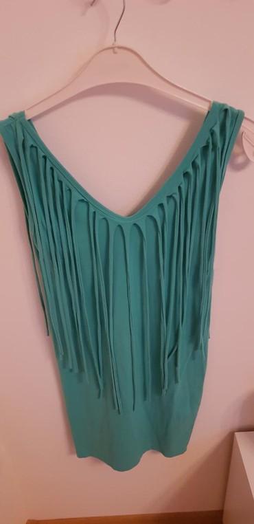 Haljine | Vrsac: Tirkizna haljinica na reseUniverzalna, ima elastinaUz teloOdgovara za