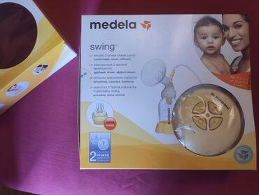 birja masaj - Azərbaycan: Elektrikli süd sağan aparat Medela swing. Həm də sağmazdan özünün