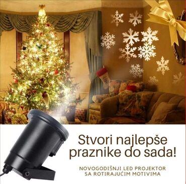 Led projektor sa rotirajućim novogodišnjim motivimaZa osvetljenje