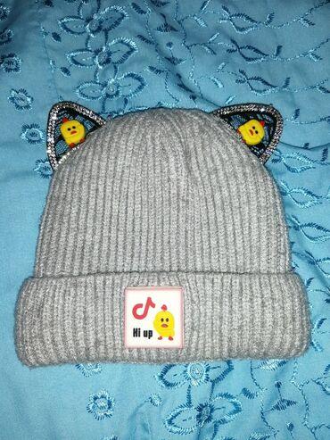 Зимняя шапка и летняя кепка в отличном састоянии шапка на 1-2 г а