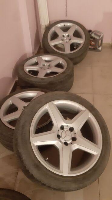 диски резина в Азербайджан: R18 Amg Tecili satilir. Rengi tezedi tekerler ela vezyetde. Svarkasi