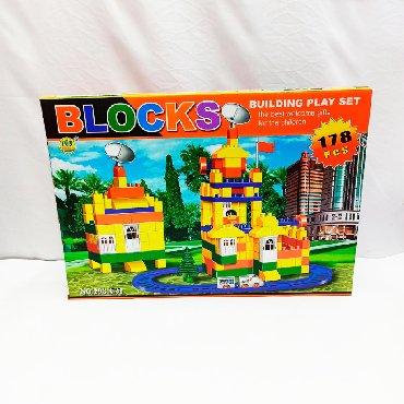 Яркий конструктор Blocks для малышей в виде вышки и здания с крупными