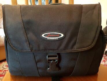 Продам сумку для фотоаппарата фирмы Jenova.Состояние идеальное, ручка