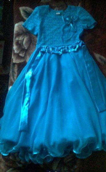 Продаю голубое длинное платье на девочку 8-10 лет.В отличном состоянии