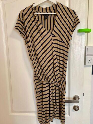 Mango haljina kratka od rastegljivog materijala.Potpuno nova