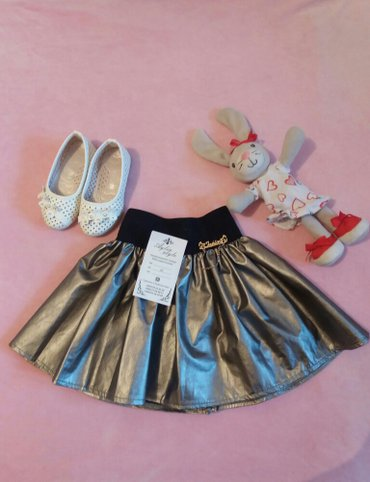 Новая юбочка из эко кожи. Подойдет принцессам от 1-3л. Цвет: серебро. в Бишкек