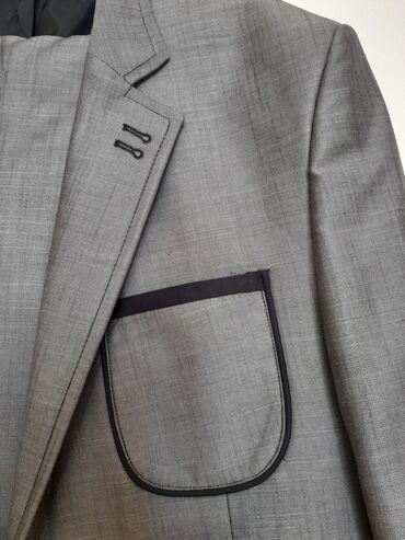 Продаю новый мужской костюм серого цвета размер 52 ( производство