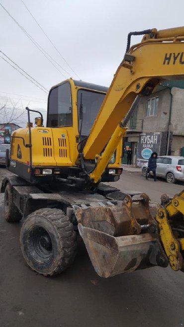 такси транспортные услуги перевозки в Кыргызстан: Услуги экскаватора