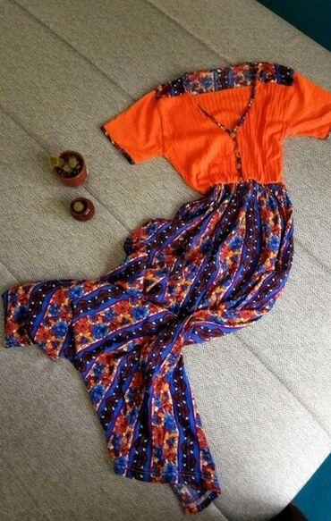 Prelepa midi/maxi haljina  Prelepo ide na preplanuli ten i ističe grud