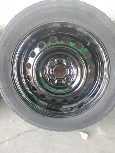 Продаю железные диски размером на 15 стандартный с летними шинами в