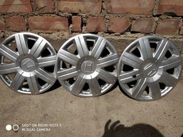 железные диски r14 в Кыргызстан: Продаю шины с железными дисками стояли на хонде стрим, запаска в