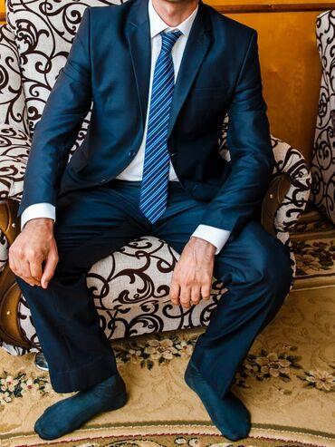 Продаю костюм темно-синего цвета,в хорошем состоянии,размер