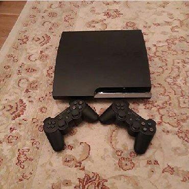 Playstation 3 slim. Ustunde 2 eded teze pult ve sunurlari