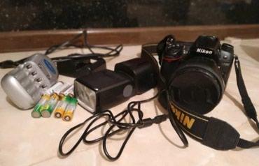 Nikon D7000+spicka+obyektiv ela veziyyetde hec bir problemi yoxdu