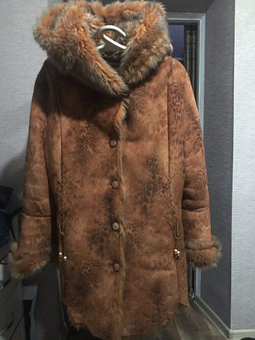 Длинная куртка дубленка, и капишеном тоже с мехомочень теплая