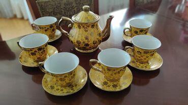 8015 объявлений: Чайный сервиз под золото, новый, форма чашек удобная