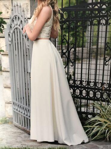 Komplet korset i suknja. Od veoma kvalitetnog materijala. Velicina 36