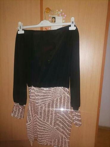 Zenska haljina, crno zlatna kombinacija boja. Uni velicina, ima