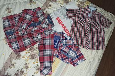 Dečija odeća i obuća - Kosovska Mitrovica: Dečije košuljeSve 3 kupljene u beba kids-u. Jedna dug rukav,druge dve