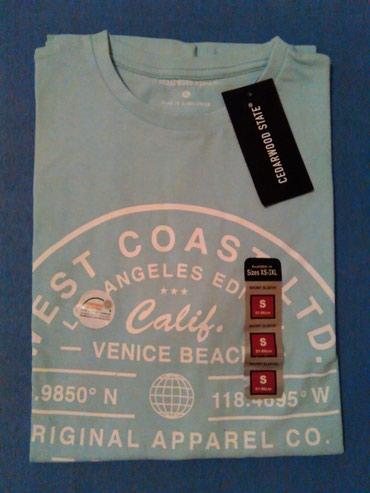 Muska majica,svetlo plava sa natpisom,marka Primark,velicina - Nis