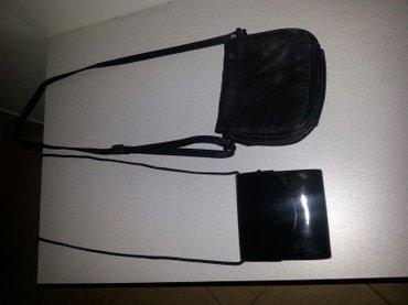 Od koze torbica - Srbija: Dve kozne torbice. Jedna lakovana. I jedna od nepromocivog platna. Sve
