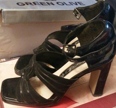 Продаю босоножки б/у  цвет черный. размер 38. каблук высокий